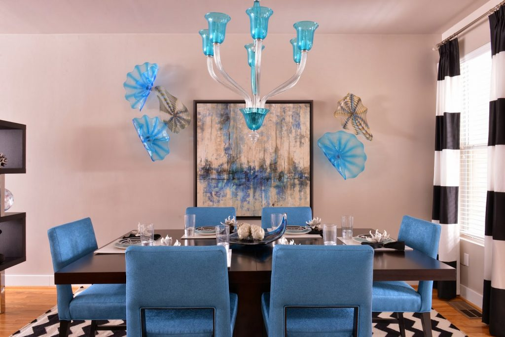 glass wall plates from viz glass and turquoise chandelier from cyan design this dining room cant wait to be used for a dinner party